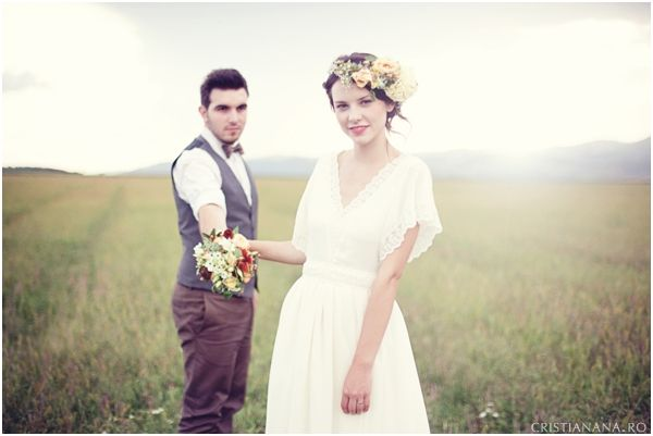 the wedding took place in Romania, her friend handmade the dress. so vintage, so elegant!