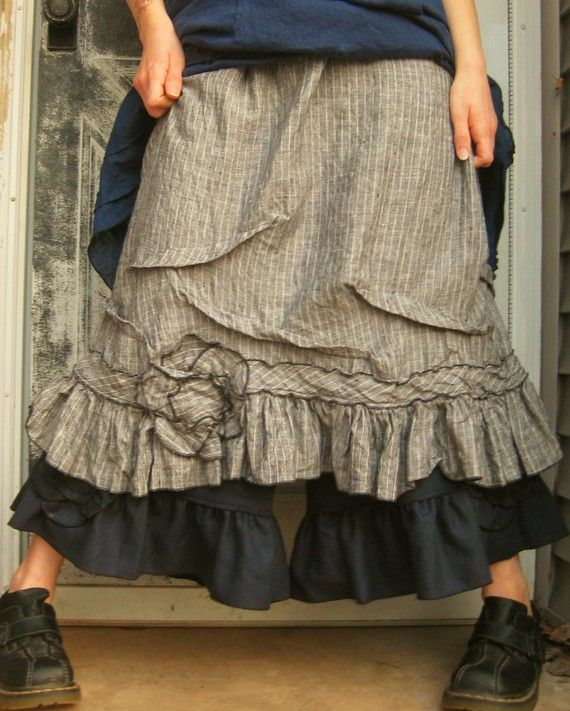 ...pin striped flower skirt, ruffled black bloomers, a white tank top, and some Wellies.  Time to feed the chickens.