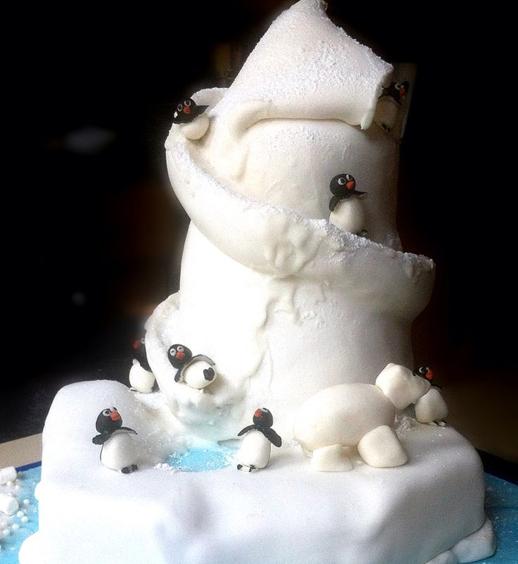 Penguin helter shelter slide Chocolate biscuit cake with marshmallow fondant