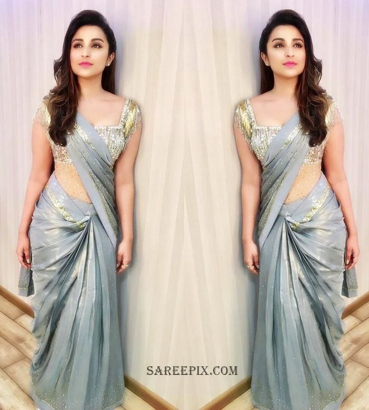 Bolly beauty Parineeti chopra saree for Stardust awards 2016. She looks beautiful in saree with wide neck blouse. One side swept hairstyle finished her cut #parineetiChopra #saree #starDustAwards2016