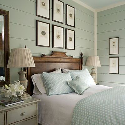I would love to have a guest bedroom like this with the wood planked walls... gorgeous! Love the color!