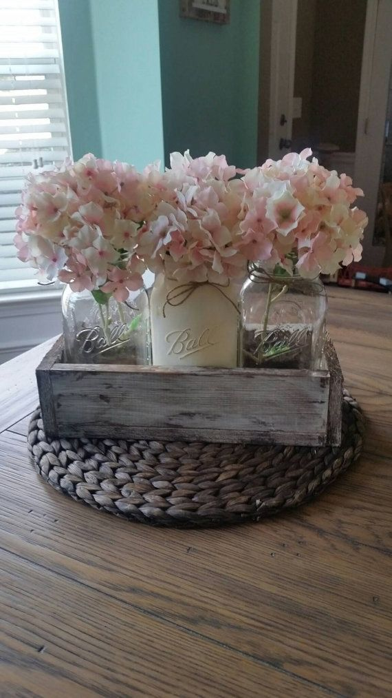This beautiful centerpiece fits 3 large jars and can be customized. Its a little over a 12 inches long and about 5.5 inches wide. The piece