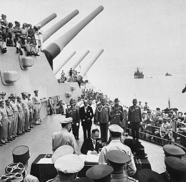 Japanese Foreign Minister Mamoru Shigemitsu signs the Japanese Instrument of Surrender, a document signed on the deck of the USS Missouri in Tokyo Bay on Sept. 2 1945 in Japan.