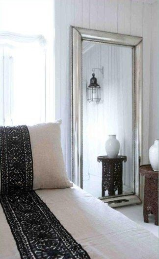 beautiful bedding with gorgeous tall mirror