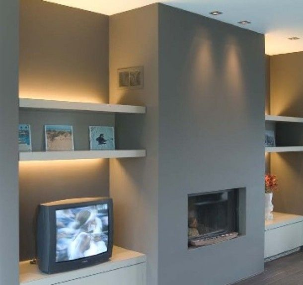simple modern cupboards (taller/higher) and shelves either side of fireplace.