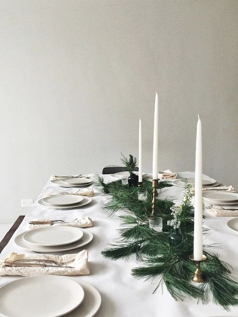 beautiful christmas table setting complete wit fir tree branches