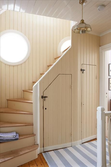 Cottage stairs with Swedish stripe runner