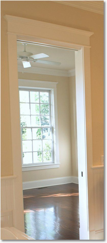 """Trim the door!  How hot is this door trim? This job has all the bells and whistles. At the base of the casing you can see the """"plinth blocks"""". And the top of this doorway is done beautifully! I say copy it exactly! and then… - www.remodelworks.com #remodel"""