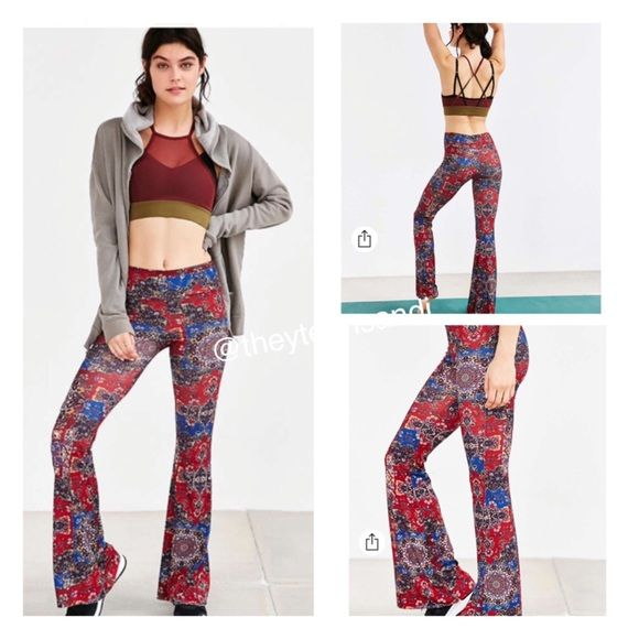 """Urban Outfitters Onzie Bell Workout Yoga Pant Soft + stretchy bell pants from Onzie featuring a mid-rise silhouette fitted through the hips + thighs with flared bottoms, in a print that's only available at Urban Outfitters. TAG SIZE M/L  Content + Care - Polyester, spandex - Hand wash - Made in the USA  Size - Measurements taken from size Medium - Inseam: 33.5"""" - Waist: 25"""" - Rise: 10.5"""" - Leg opening: 26"""" Urban Outfitters Pants Leggings"""