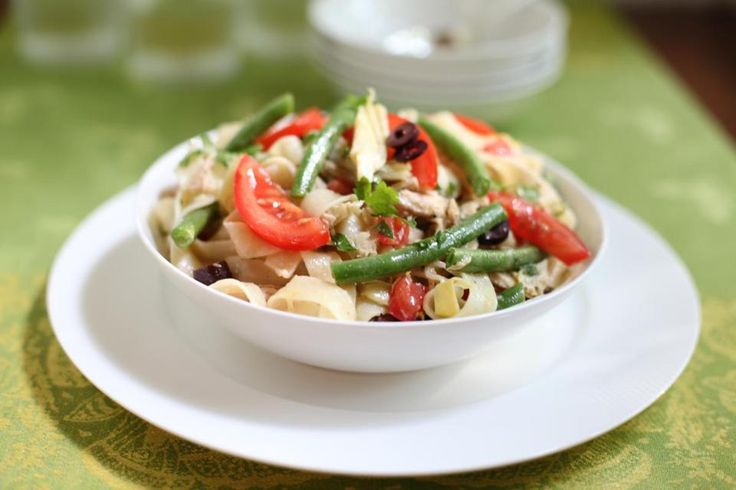 Delicious pasta nicoise recipe from the Boston Globe (tomato, artichoke, olive, green bean). No need to cook the green beans separately - just add them in with the pasta at the end. I halved the recipe to avoid having too much left over. #pasta #entree #fish