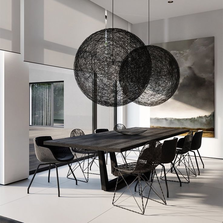 Woven orbs hang in the dining area.  Moooi Random Round ball Pendant Light