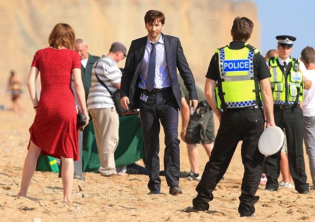 """""""Tenth Doctor, David Tennant, will be returning to BBC America in Spring 2013 in the eight-part crime drama, """"Broadchurch."""" Tennant plays Detective Inspector Alec Hardy, a by-the-book cop sent to investigate a murder of a boy in a small UK seaside town. Fellow Doctor Who alum, Arthur Darvill (Rory Williams) is cast as the town priest, Paul Coates."""" Obviously, I will be watching this show."""