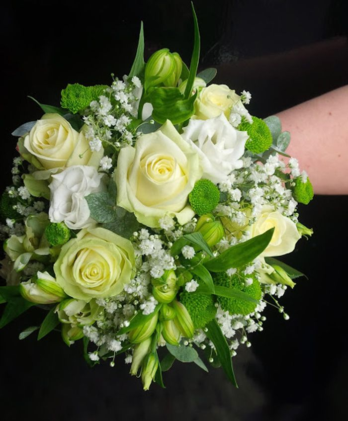A striking combinations of lime green and cream avalanche roses. A beautiful bridal bouquet created by Head Florist at Isle of Wight Flowers, Charlotte King http://www.isleofwightflowers.co.uk/
