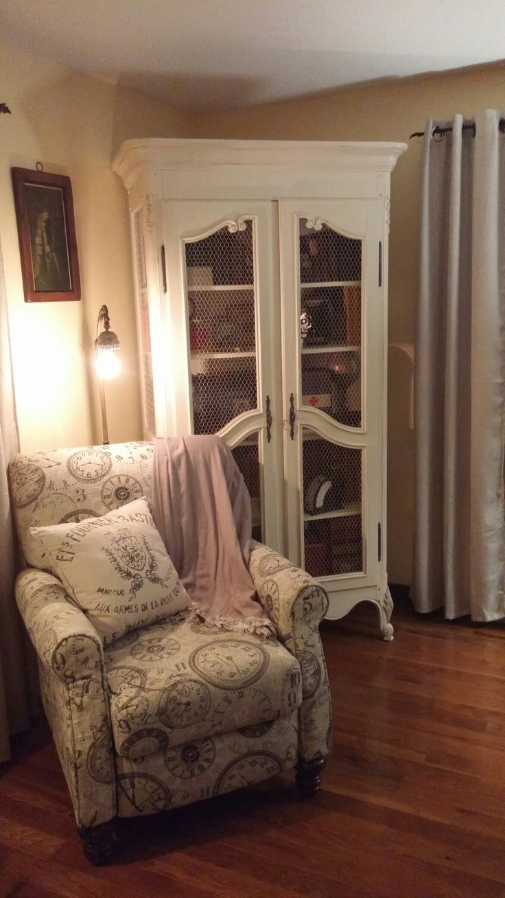 Antique french armoire in white, country look with chicken wire, provincial feet, antique books, antique victorian floor lamp.