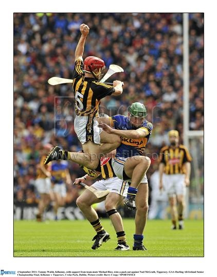 Tommy Walsh Kilkenny's wing back. Classic aggressive catching, clearing everything out of the way to catch the ball