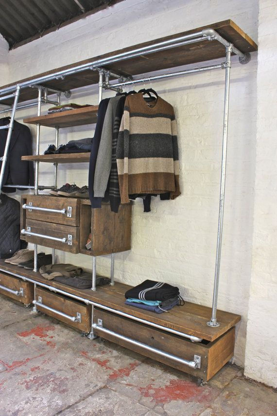 Medium Oak Stained Reclaimed Pine Scaffolding Boards and Galvanised Steel Pipe Wall Mounted and Floor Standing Industrial Chic Dressing Room Wardrobe system - Its industrial design works perfectly in an urban sophisticated, casual living space... This shelving system can be made to measure to your own specifications. The unit pictured here is 3000mm wide x 1968mm tall x 518mm deep (including ladder at an 8 degree angle the depth is 899mm)... and the galvanised pipe has a diameter of 27mm…