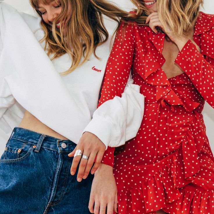 Shop cult brands and styles from Instagram. Carmen Hamilton wears red Realisation Par star dress. Annabel Blue wears Double Trouble Gang 'Lover' embroidered sweatshirt and Levi's jeans.