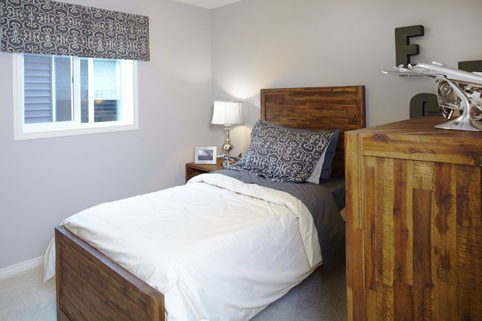 Spare bedroom or a children's bedroom in the Orion II showhome in King's Heights in Airdrie by Shane Homes.