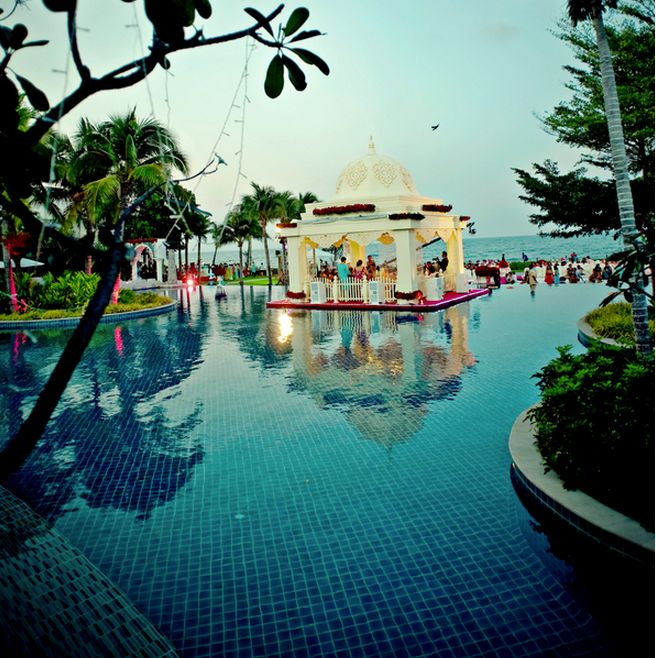 Breathtaking Rose Adorned Mandap In A Pool Overlooking The