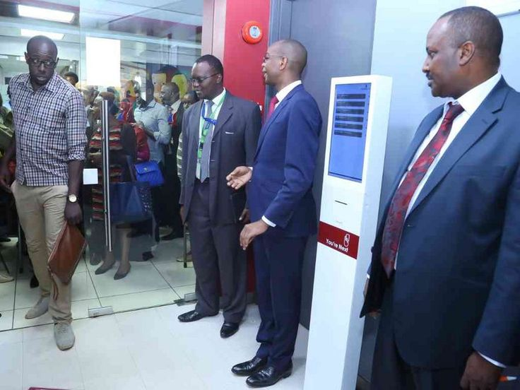 Customers are welcomed inside a Chase Bank branch during the reopening of the bank on April 27 by Kenya Commercial Bank's head of IT Leornard Muthiga, KCB Group CEO Joshua Oigara and KDIC acting CEO Mohamud Ahmed.
