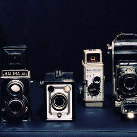 old fashion cameras; arrange on a shelf around old family pictures...