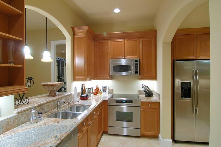 Image result for countertops with oak and stainless steel appliances