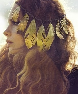 Love the gold feathers with her hair