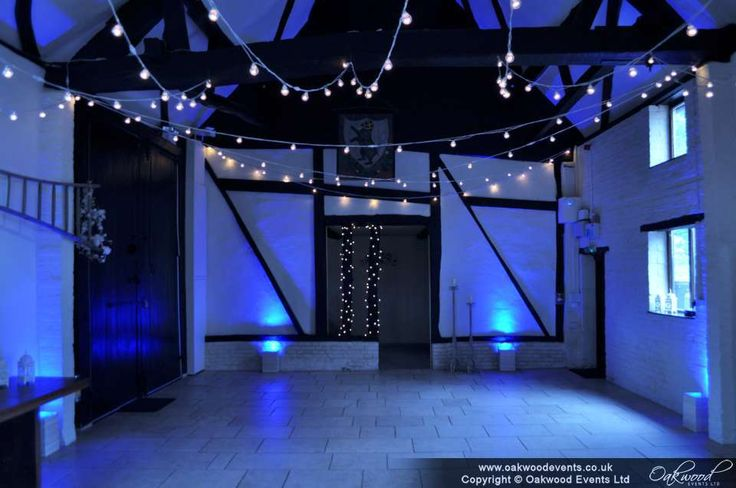 Changing the mood for the evening, with blue uplighting alongside fairy lights and a festoon canopy in the barn