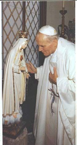 Our Lady of Fatima  Pope John Paul II pictured here thanking the virgin for her intervention when he was shot (the bullet was added to her crown).