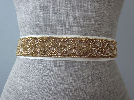 Very gorgeous deco style beaded trim in deep gold seed and bugle beads. Very limited vintage trim.  This is a one size fits most ribbon tied