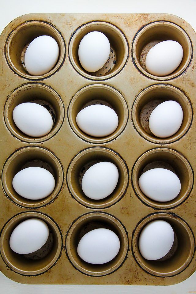 Perfectly hard boiled eggs made in a muffin tin. They are ready in just 30 minutes, and the egg shells practically fall off on their own.