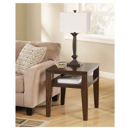 When done just right, simplicity can be simply striking—as is the case with this rectangular end table. Clean lines, subtly flared legs and an open design give it a great sense of ease, while a decadent finish exudes rich character.   Signature Design by Ashley is a registered trademark of Ashley Furniture Industries, Inc.