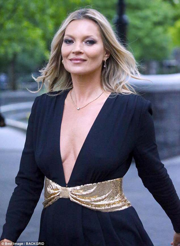 fb38623293 Kate Moss goes braless in a plunging playsuit at Saint Laurent show