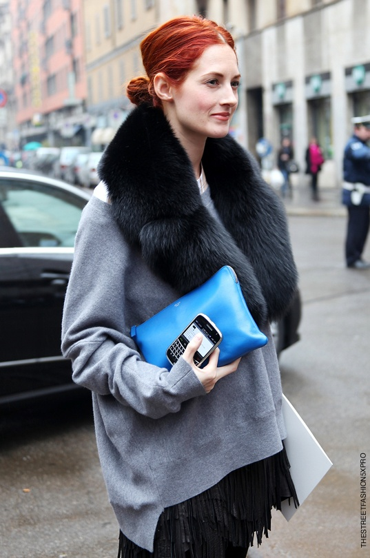 Taylor Tomasi Hill in an oversized sweater, clutch and trendy scarf.