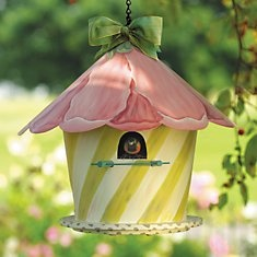I made a cupcake birdhouse in college. Looks quite similar to this, a flower house.