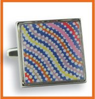 Scorched Earth Cufflinks Artist:  Peggy Nampijinpa Brown made in Australia dimensions:  1.7cm x 1.7cm Silver metal cufflink with colour design        enamel finish Boxed with Artist/design details  PRICE:  $44.00 Code:  CUFF-SECL08  DISCONTINUED - 2 LEFT