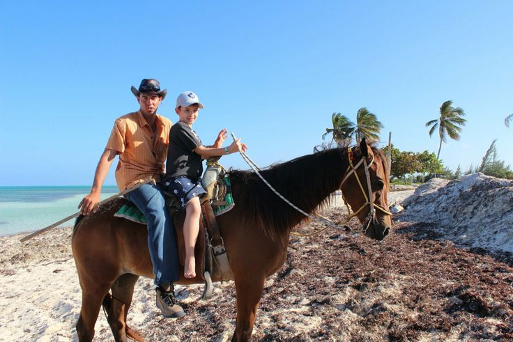 Owen with Cuba Cowboy on the beach.