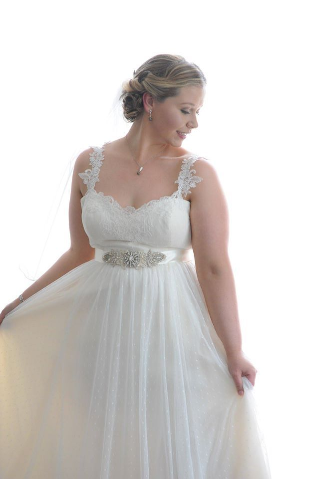 Empire waist plus size wedding dresses are flattering to the curvy body. This style has vintage style lace straps and a rhinestone beaded motif on a ribbon sash.  Gather information about custom plus size wedding dresses, pricing, replicas and see other designs for the full figured bride at http://www.dariuscordell.com/featured_item/plus-size-wedding-dresses-bridal-gowns/