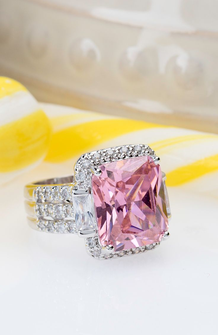 Pop! This bubblegum pink ring is bubble yum in our eyes! We need this popping pink to brighten up our jewelry box. | 17.76ctw Pink & White Diamond Simulant Rhodium Plated Sterling Silver Ring