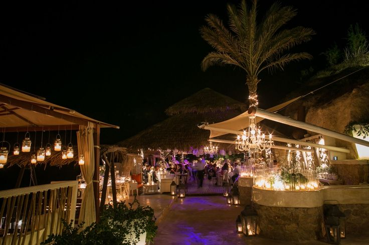 Millions of hanging lanterns, glass tubes with candles and the hanging chandelier make up the most intimate and luxurious ambience for the wedding reception.