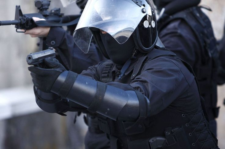 I've been looking for police supplies for a while now.  We live in a dangerous neighborhood and it would be nice to have some gear.  I wonder where I could buy body armor like this and ammunition.