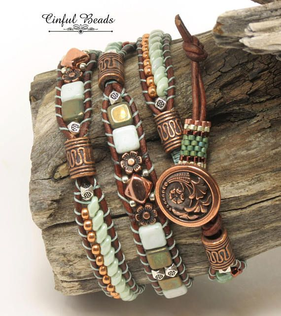 A stylish Bohemian wrap bracelet. This bracelet has 3 sections and features different beads in each section. The first section is composed of prarie green superduos flanked by Miyuki duracoat galvanized muscat seed beads. The center section is made of Czechmate tiles in oxidized