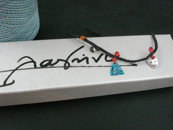 bracelet of waxed cords and silver elements