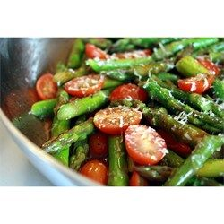 This side dish involves steaming asparagus and grape tomatoes and topping with olive oil and Parmesan cheese.
