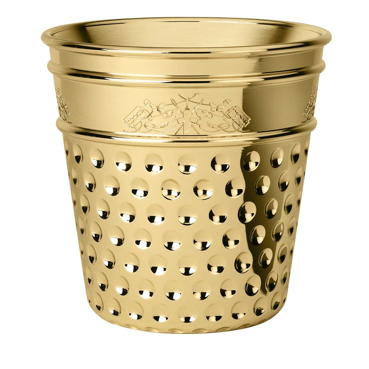 The shape of this exquisite steel ice bucket with a brass finish designed by Studio Job is that of a giant thimble and it is inspired by the family's tailoring tradition. A whimsical etching decorates the top side with butterflies and small artisan's tools and represents the care for each small detail.