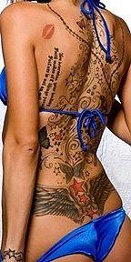 Lips, stars, butterflies, quote tattoo