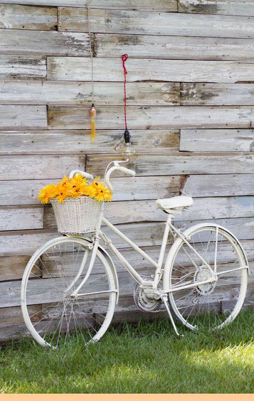 Vintage bike, wood wall & nostalgic bare bulb pendants! #barebulb #lightingpendants