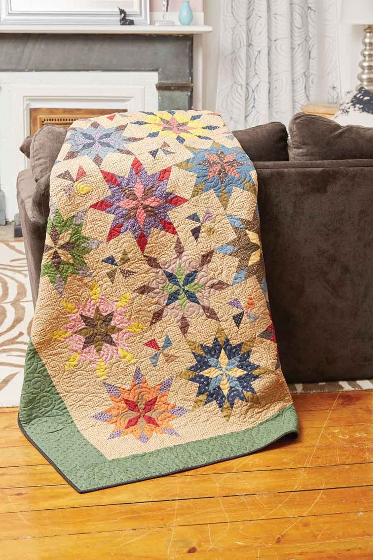 The Blazing Star quilt block, or Star of the East quilt block, in Summer Fireworks, by Christina McCourt, are strip-pieced, and when joined together, the corners form pinwheels. Gorgeous!
