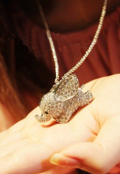 Rhinestone Flying Elephant Necklace. Adorable. A little too blingy, but still. Cute.