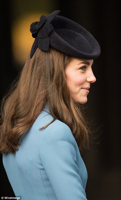 Portrait of a princess: Kate showcases the detail of her Lock and Co hat from the back as she smiles a cheeky grin - February 7, 2016